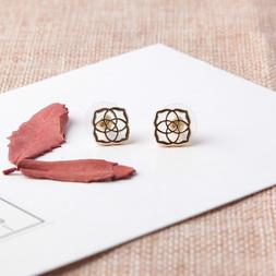 dira logo stud earrings gold tone