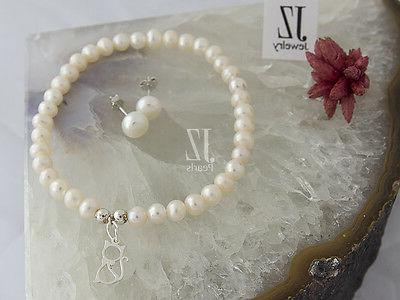 Freshwater Pearl Bracelet with S/Silver Charm S/Silver Stud
